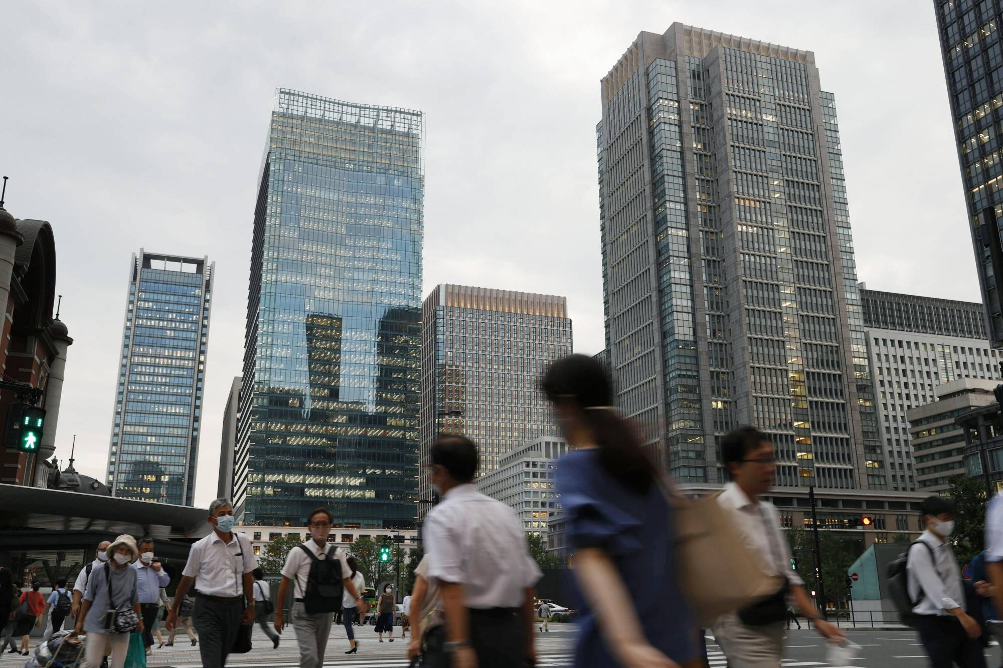 About 2.4 million furloughed workers are currently being kept on payrolls backed by state subsidies. | KYODO