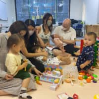Play break: Geoff and Chikako Morris provide a place for kids to play around and moms to get some things off their chests.  | H.J. MILON