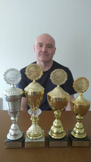 Simon Siddall displays four of his five championship trophies earlier this month.   SIMON SIDDALL