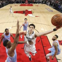 Memphis forward Yuta Watanabe goes for a layup against the Bulls in December. The 25-year-old completed his second season in the NBA and G League.  | KYODO