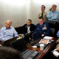 Seen in the Situation Room of the White House in May 2011, U.S. President Barack Obama and Vice President Joe Biden, along with members of the national security team, receive an update on the mission against Osama bin Laden. | WHITE HOUSE / VIA REUTERS