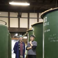 Team effort: Hayato Shoji (right) and Justin Potts in front of Kidoizumi Brewery's brewing tanks