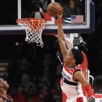 Wizards forward Rui Hachimura goes up for a dunk during a game against the Bulls in Washington on Feb. 11. | AP
