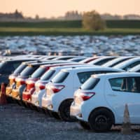 New Toyota Yaris automobiles sit in a parking lot at the Toyota Motor Corp. plant as it resumes operations in Onnaing, France, on April 21. | BLOOMBERG