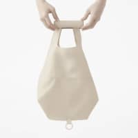 Get a grip: Nendo's Roll-up Ecobag comes in a sturdy tubular case that doubles as a handle.   AKIHIRO YOSHIDA