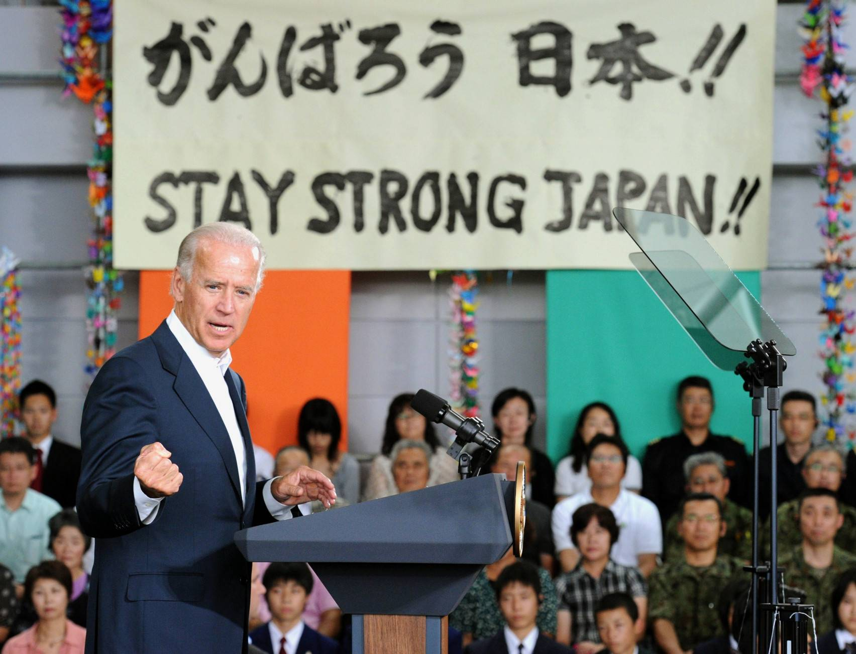 U.S. Vice President Joe Biden delivers a speech in front of people affected by the March 11 earthquake and tsunami, at Sendai Airport on Aug. 23, 2011.   KYODO