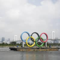 More than half of nearly 13,000 Japanese companies surveyed are opposed to the Tokyo Olympics and Paralympics being held in the summer of 2021. | AP
