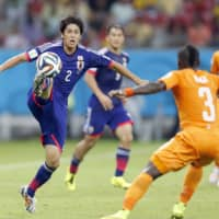 Atsuto Uchida plays against Cote d'Ivoire in the World Cup in Recife, Brazil, in June 2014. | KYODO
