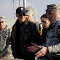 Vice President Joe Biden is briefed during a tour of the Demilitarized Zone separating the two Koreas in Panmunjom, South Korea, in December 2013. | POOL / VIA REUTERS
