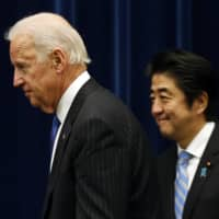 U.S. Vice President Joe Biden and Prime Minister Shinzo Abe arrive for a joint news conference following their meeting in Tokyo in December 2013.  | REUTERS