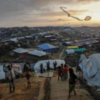 Rohingya refugee children fly improvised kites at the Kutupalong refugee camp near Cox's Bazar, Bangladesh, in 2017.  | REUTERS