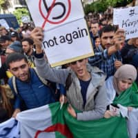 Algerians hold an anti-government protest in Algiers on Nov. 26 of last year. | AFP-JIJI