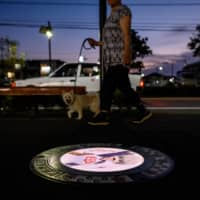 Tokorozawa has increased security patrols near the manhole covers to deter would-be thieves. | AFP-JIJI