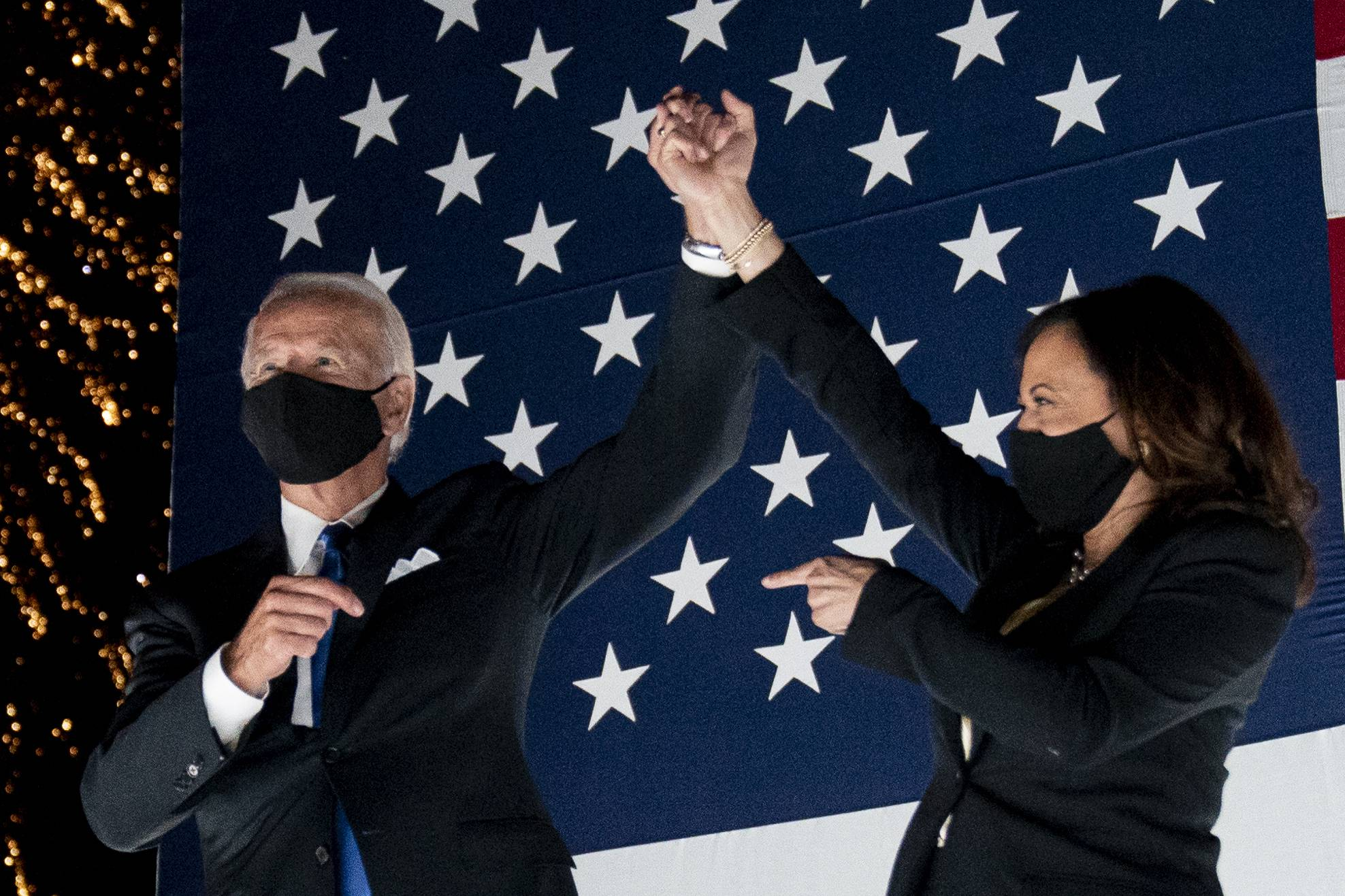 Democratic presidential candidate former Vice President Joe Biden and his running mate, Sen. Kamala Harris, watch fireworks during the fourth day of the Democratic National Convention on Thursday in Wilmington, Delaware.   AP
