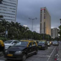 Vehicles sit in traffic in Mumbai last September. | BLOOMBERG