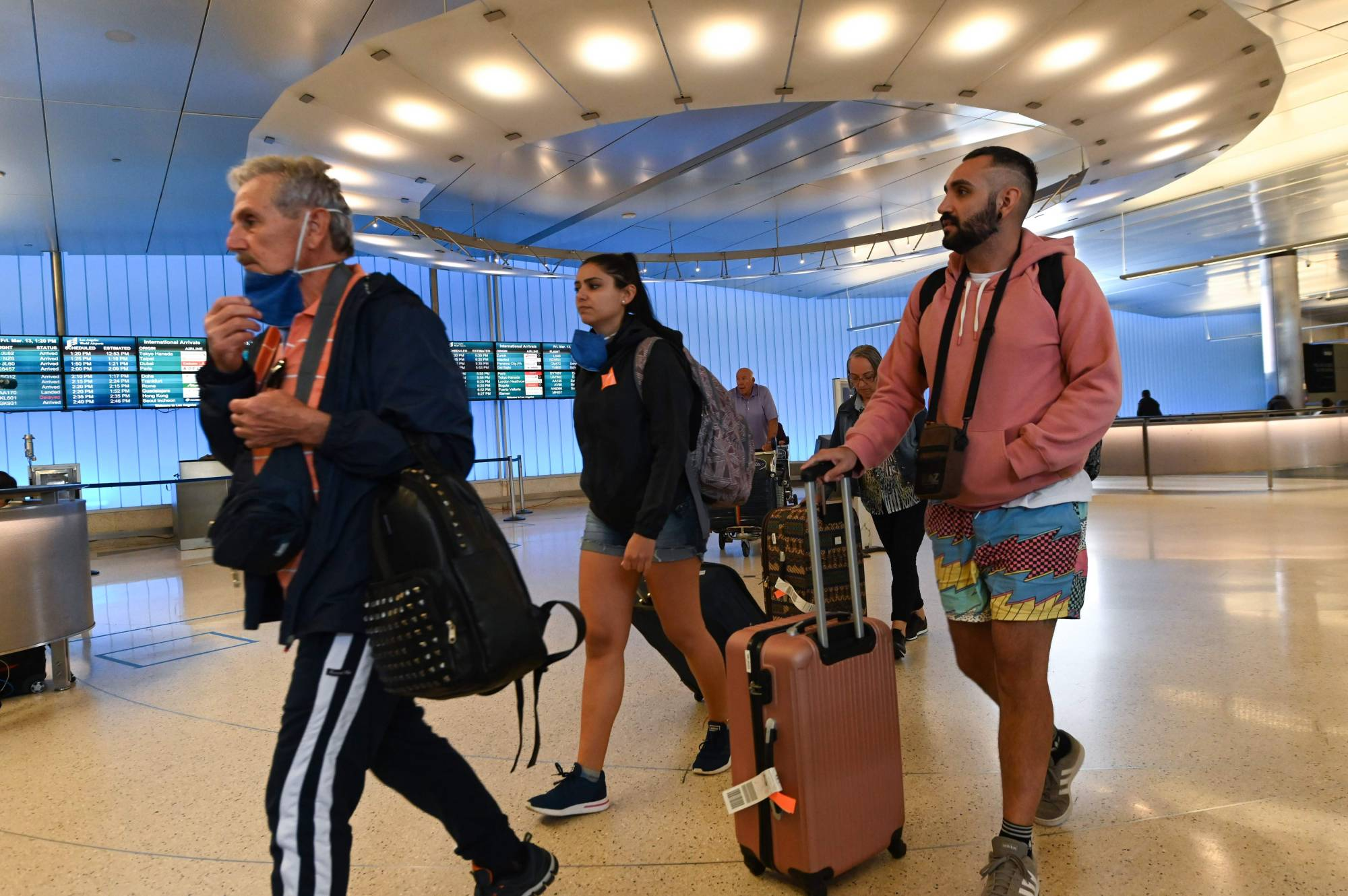 Passengers arrive at Los Angeles Airport's international terminal hours before the start of the European travel ban on March 13.  | AFP-JIJI