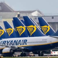 Ryanair jets wait on the tarmac at Dublin airport on March 23. Ryanair will cut its September and October timetable by '20 percent' on weaker-than-expected demand following renewed travel restrictions in some European countries, the no-frills airline said Monday. | AFP-JIJI