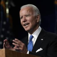 Joe Biden says he would shut down the U.S. if scientists recommend it