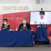 Tokyo Paralympics organizers discuss the competition's new schedule during an Aug. 3 news conference in Tokyo's Chuo Ward. | POOL / VIA KYODO
