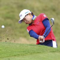 Hinako Shibuno hits from out of the bunker during the second round of the Women's British Open on Friday in Troon, Scotland. | THE R&A / VIA GETTY / VIA KYODO