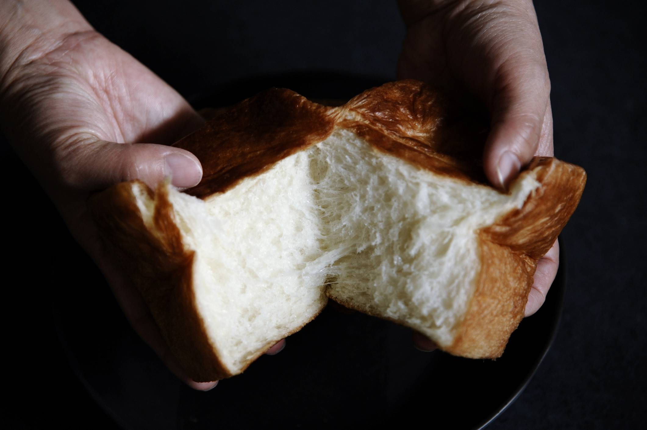 Consumers have been lining up for hours to purchase high-end products such as the white and pillowy square-shaped bread called shokupan. | GETTY IMAGES