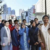 Foreign students pose for a photo on their way to attending their coming-of-age ceremony in Tokyo in January 2019.   KYODO