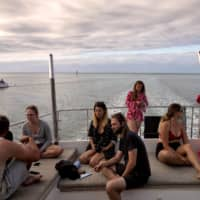 Passengers head back to Cairns after exploring the Great Barrier Reef.  | NATALIE GRONO / THE NEW YORK TIMES