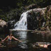 Backpackers cool off at the Crystal Cascades outside of Cairns.  | NATALIE GRONO / THE NEW YORK TIMES