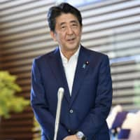 Prime Minister Shinzo Abe addresses reporters at his office in Tokyo Wednesday after returning to work following a three-day break that included a medical checkup at Keio University Hospital amid speculation about his health. | KYODO