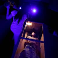 An actor dressed as zombie performs during a coffin horror show performed by Kowagarasetai (Scare Squad) in Tokyo on Saturday. | REUTERS