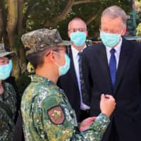 Brent Christensen, director of the American Institute in Taiwan, talks to soldiers after attending an event to mark the 62nd anniversary of the Second Taiwan Strait crisis in Kinmen, Taiwan, on Sunday.  | REUTERS