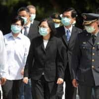 Taiwan President Tsai Ing-wen leaves after paying her respects to the deceased during an event to mark the 62nd anniversary of the Second Taiwan Strait crisis in Kinmen on Sunday.  | REUTERS