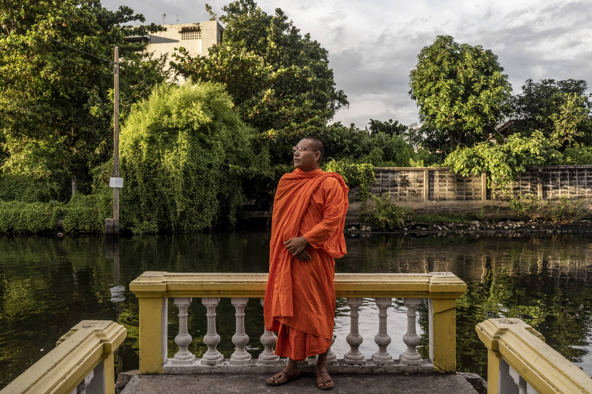Luon Sovath, a Cambodian monk and rights activist who fled Cambodia, poses in Bangkok in July 2020.   ADAM DEAN / THE NEW YORK TIMES