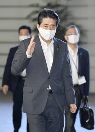 Prime Minister Shinzo Abe arrives at his office in Tokyo on Friday. | KYODO