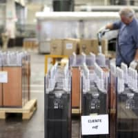 A FIAMM employee prepares batteries for French client EDF at the battery-maker's factory in Avezzano, Italy. | REUTERS