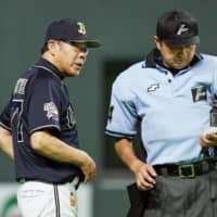 Orix manager Norifumi Nishimura, seen speaking to an umpire on July 28 in Sapporo, resigned following a loss Thursday. | KYODO