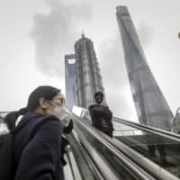 Some fund managers are bracing for defaults on domestic Chinese debt to hit record highs this year. | BLOOMBERG