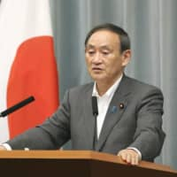 Chief Cabinet Secretary Yoshihide Suga speaks in a news conference at the Prime Minister's Office Monday. | KYODO