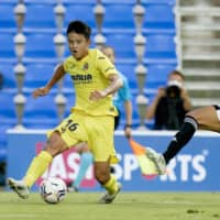Takefusa Kubo (left) competes for Villarreal during a friendly on Sunday in San Pedro de Pinatar, Spain. | KYODO