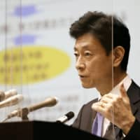 Yasutoshi Nishimura, who is charge of the government's coronavirus response, speaks at a news conference on Friday.    KYODO