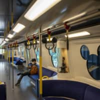 A passenger rides on the Disneyland Resort line in Hong Kong in March.  | BLOOMBERG