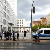Members of the media stand outside Berlin's Charite Mitte Hospital Complex, where Russian opposition leader Alexei Navalny is receiving medical treatment.  | REUTERS