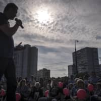 Alexei Navalny, a lawyer-turned-blogger and political opponent of Vladimir Putin, speaks during his election campaign to become the mayor of Moscow in August 2013.  | SERGEY PONOMAREV/THE NEW YORK TIMES