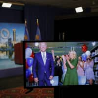 Democratic presidential candidate Joe Biden is seen in a video feed from Delaware with his wife, Jill, and his grandchildren during the virtual 2020 Democratic National Convention in Milwaukee, Wisconsin, on Aug. 18. | AP