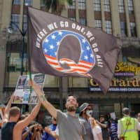 Russian-backed organizations amplifying QAnon conspiracy theories, researchers say