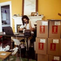 Wrapped up: Ferreira in his Nashville home individually packing up his albums to ship to fans. | ALYSSE GAFKJEN / THE NEW YORK TIMES