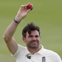 England's James Anderson holds up the ball to celebrate his 600th test wicket after dismissing Pakistan's captain Azhar Ali during the fifth day of the third cricket test match between England and Pakistan on Tuesday in Southampton, England. | AP
