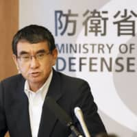 Defense Minister Taro Kono speaks to reporters at a news conference held at the Defense Ministry in July. | KYODO