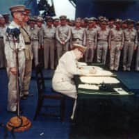 U.S. Gen. Douglas MacArthur signed the Instrument of Surrender aboard the U.S. Navy battleship USS Missouri in Tokyo Bay on Sept. 2, 1945. | U.S. ARMY SIGNAL CORPS / U.S. NATIONAL ARCHIVES / HANDOUT / VIA REUTERS