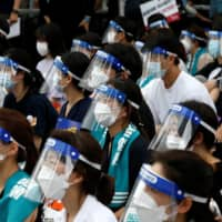 Medical residents and doctors attend a 24-hour strike to protest a government plan in Seoul on Aug. 14.  | REUTERS